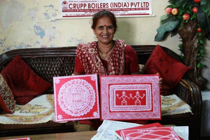 A Kumaoni Lady showing Aipan Art work