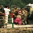 Indian Army taking pilgrims to helicopters